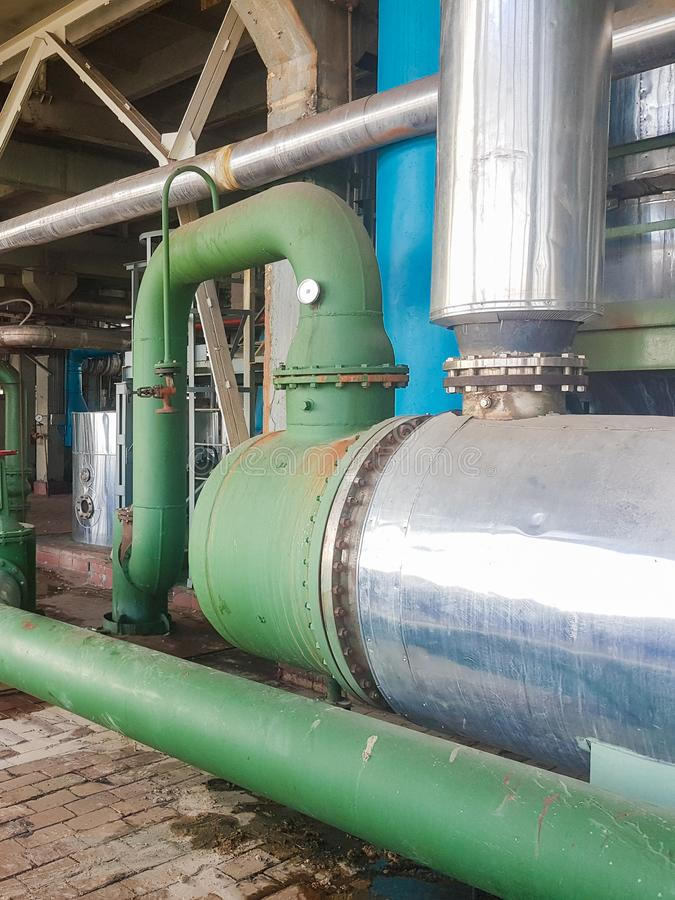 Chemical plant inside. Pneumatic flow control valve for industrial refinery or chemical plant. Equipment, cables and pipelines stock photos