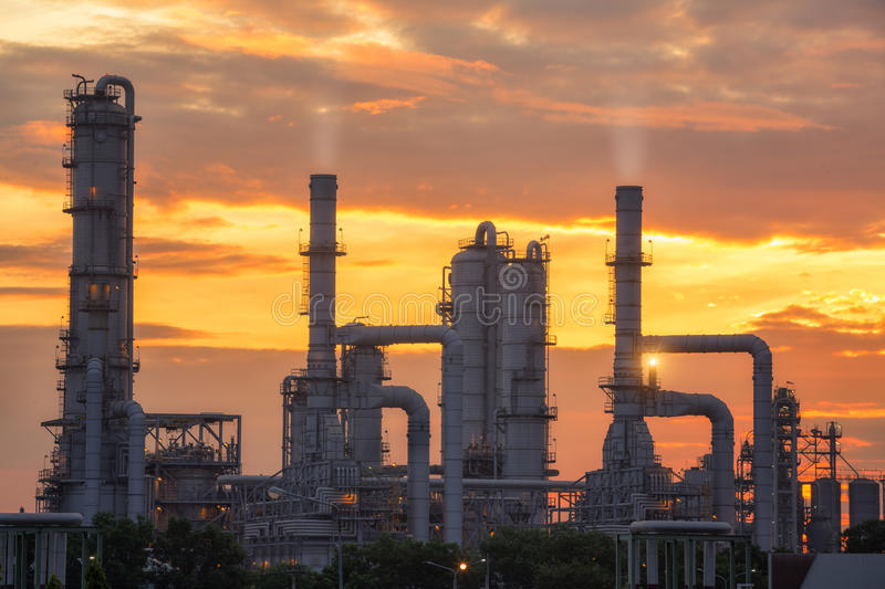 Chemical plant and oil refinery industry with sunrise stock photography