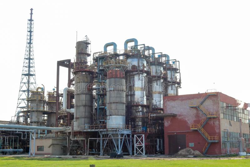 Chemical plant for the processing of petroleum products with rectification columns, reactors, heat exchangers, pipes at an oil ref. Inery, petrochemical royalty free stock photography