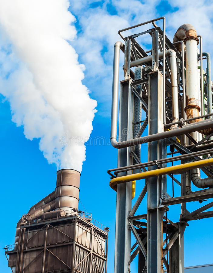 Chemical plant and smokestack forfactory. Pipes of chemical plant for factory, with smokestack on blue sky royalty free stock photos