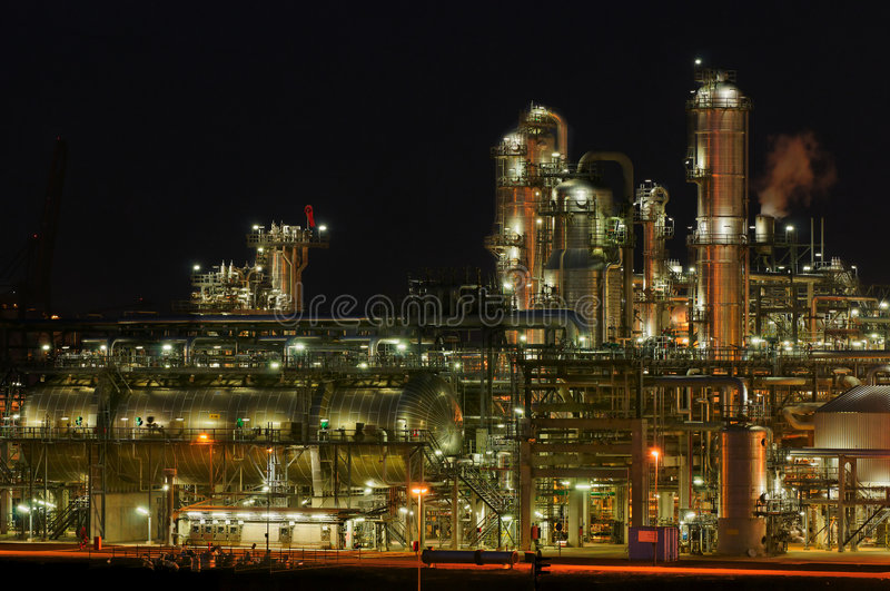 Chemical production facility at night stock photos