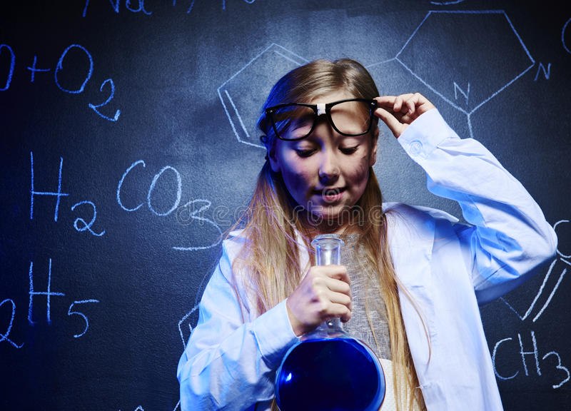 Chemical science. Blonde scientist looking at chemistry liquid stock photography