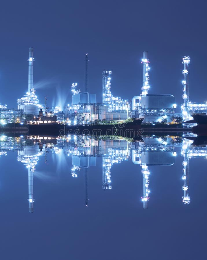 Chemical tanker ship with oil refinery. The chemical tanker ship with oil refinery industry port background as in logistics shipping background royalty free stock photography