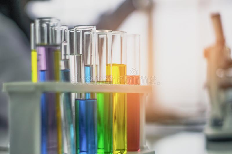 Chemical tube, put on table, With colorful fluids, In glass tubes for cosmetics from notebooks, in the laboratory, the concept. Develops safe formulas for royalty free stock photo