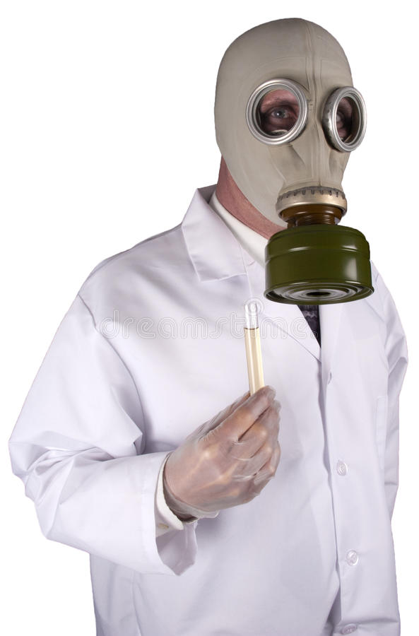 Chemical Warfare, Bio Terrorism, Toxic Chemicals. Concept for a broad subject of ideas, a scientist wearing a gas mask and holding a test tube of toxic chemicals royalty free stock photography