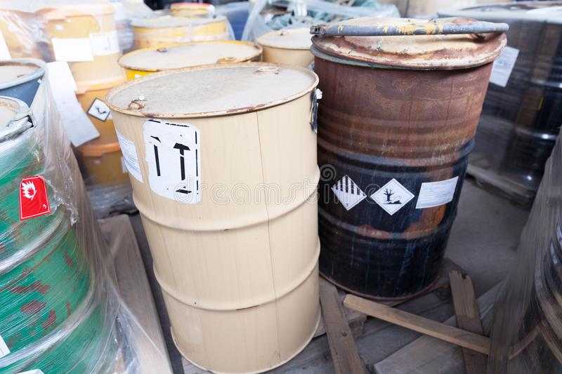 Chemical waste dumped in rusty barrels. Rusty barrels with toxic chemical waste royalty free stock photos