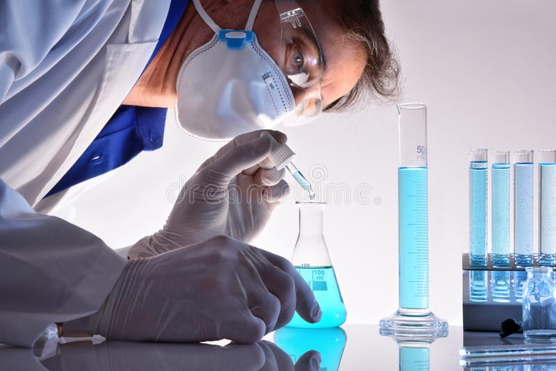 Chemical worker testing different substances in the laboratory stock photos