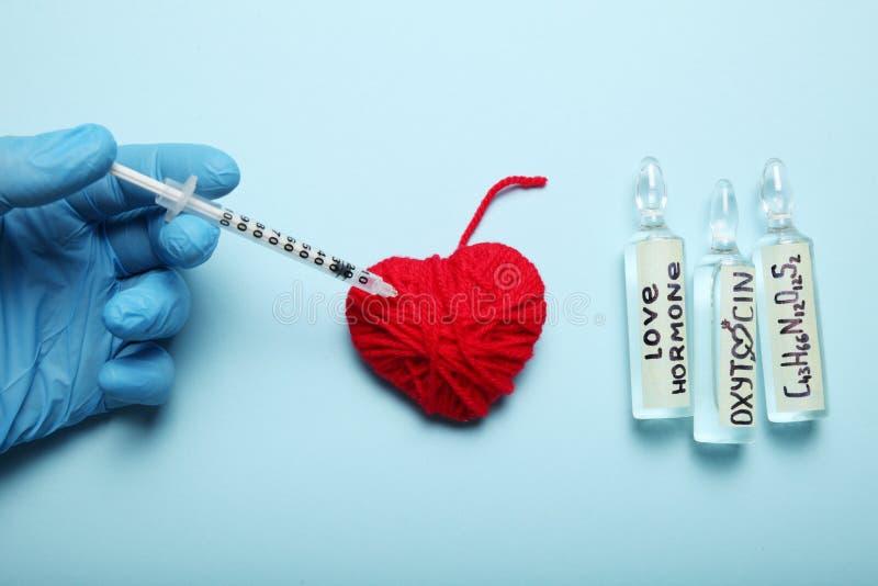 Chemische oxytocin ontdekking Liefdeanalyse, hormoon stock foto's