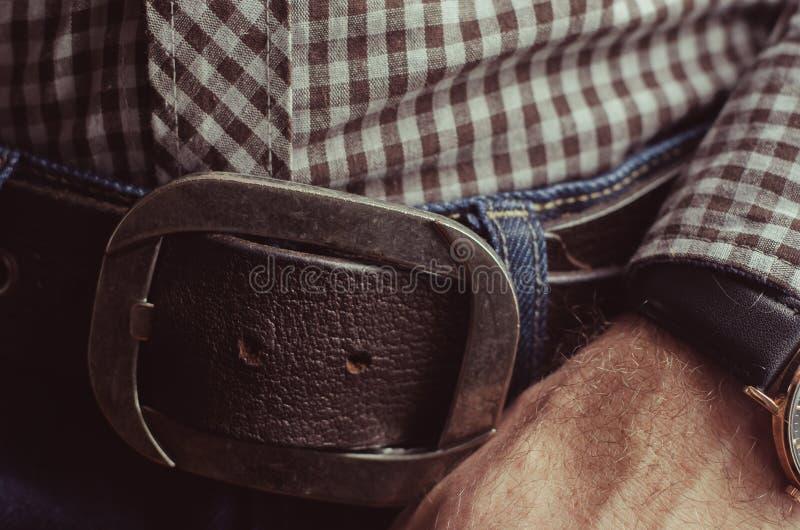 Chemise, jeans, fond humain de main photo stock