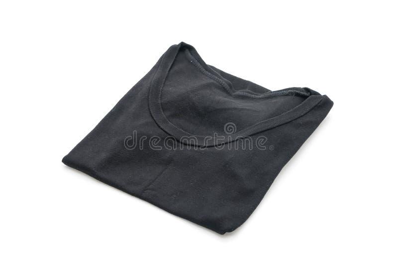 chemise T-shirt plié sur le blanc image libre de droits