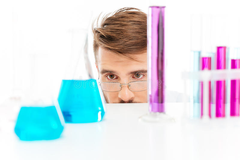 Chemist is analyzing sample stock photography
