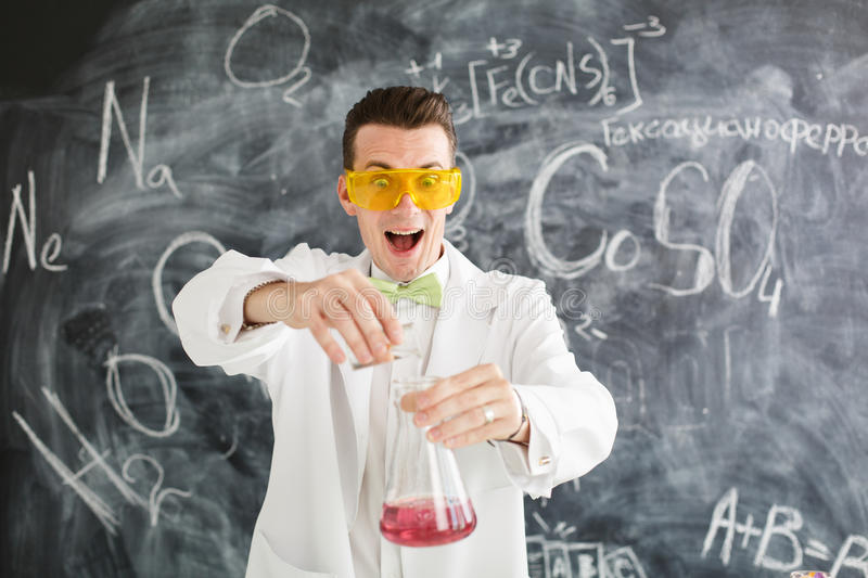 Chemist carries chemistry experiment in laboratory. Test-tubes with chemical reagent. Chemical Laboratory. Chemistry lesson. Study chemistry. Scientist at stock images