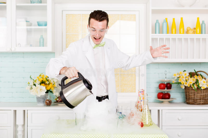 Chemist carries chemistry experiment in laboratory. Test-tubes with chemical reagent. Chemical Laboratory. Chemistry lesson. Study chemistry. Scientist at royalty free stock photography