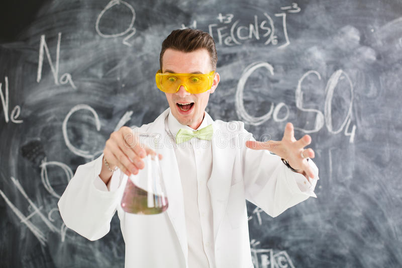 Chemist carries chemistry experiment in laboratory. Test-tubes with chemical reagent. Chemical Laboratory. Chemistry lesson. Study chemistry. Scientist at royalty free stock photo