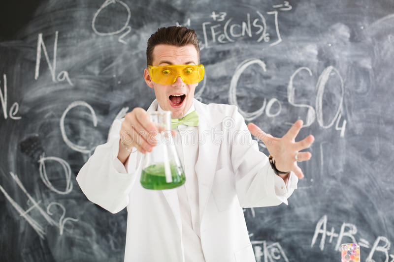 Chemist carries chemistry experiment in laboratory. Test-tubes with chemical reagent. Chemical Laboratory. Chemistry lesson. Study chemistry. Scientist at stock image
