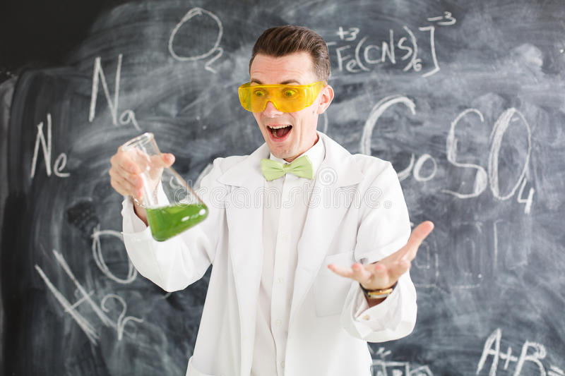 Chemist carries chemistry experiment in laboratory. Test-tubes with chemical reagent. Chemical Laboratory. Chemistry lesson. Study chemistry. Scientist at stock photography