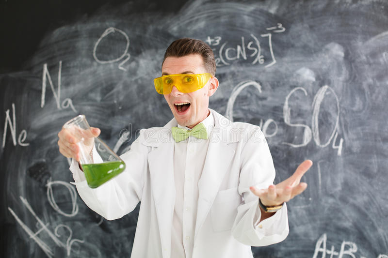 Chemist carries chemistry experiment in laboratory. Test-tubes with chemical reagent. Chemical Laboratory. Chemistry lesson. Study chemistry. Scientist at royalty free stock images