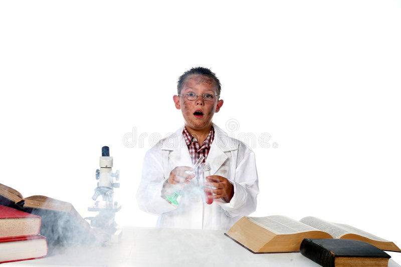 Chemist child making smoke from experiment stock photos