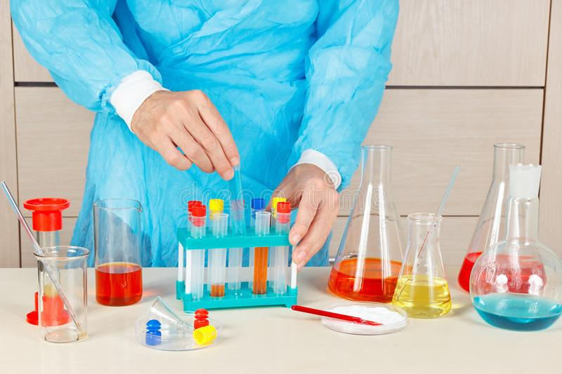 Chemist doing chemical research in laboratory royalty free stock images