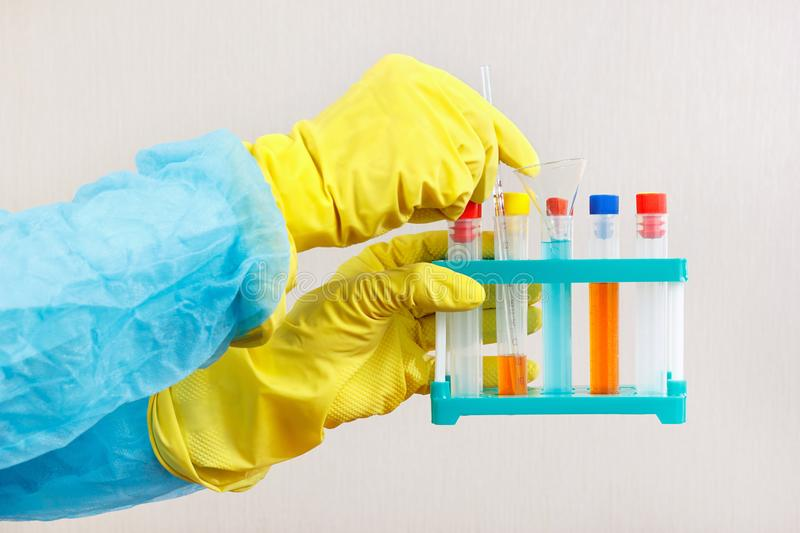 Chemist hands in rubber gloves doing chemical experiments in laboratory royalty free stock photos