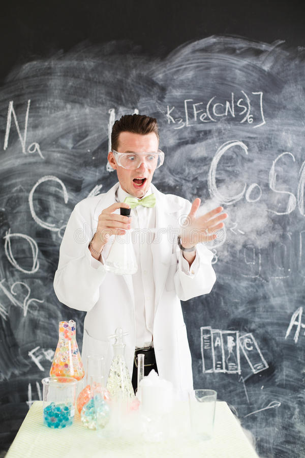 Chemist makes an experiment. royalty free stock photos