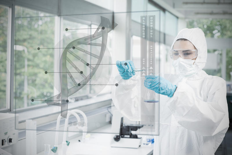 Chemist in protective suit working with futuristic interface wit. H dna diagram on it stock photography