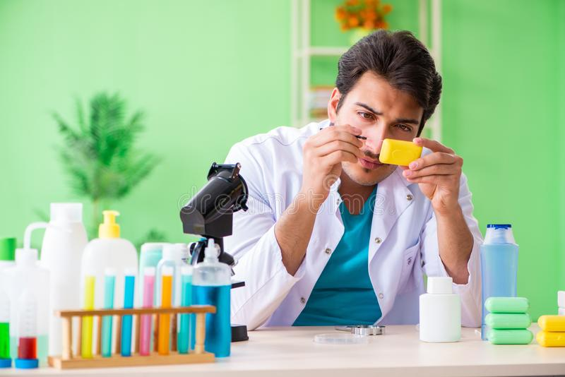 The chemist testing soap in the lab royalty free stock photo