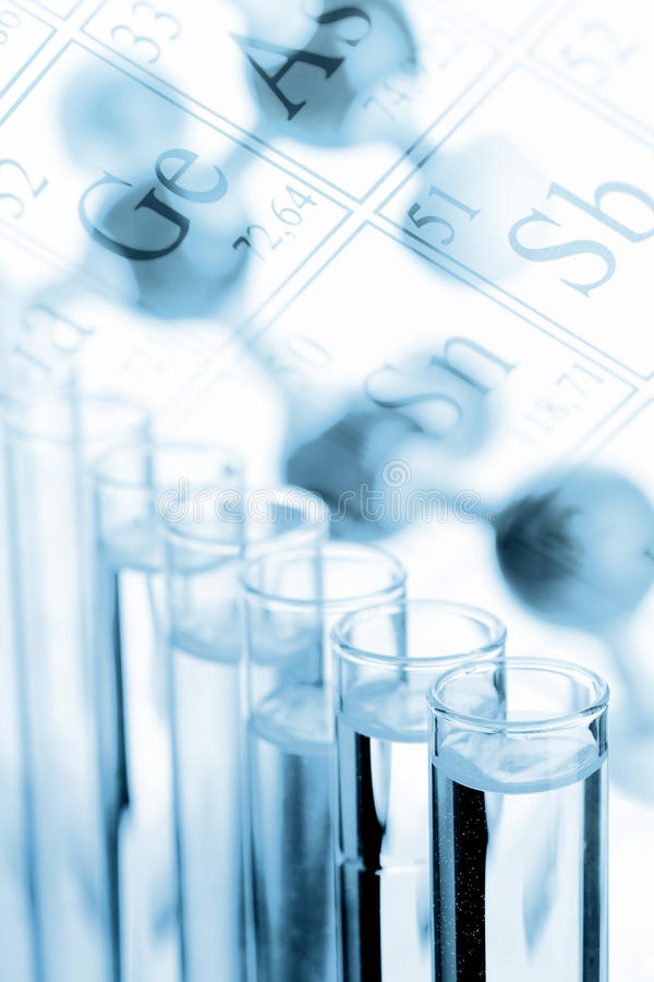 Chemistry or biology background - test tubes with molecule model royalty free stock photo