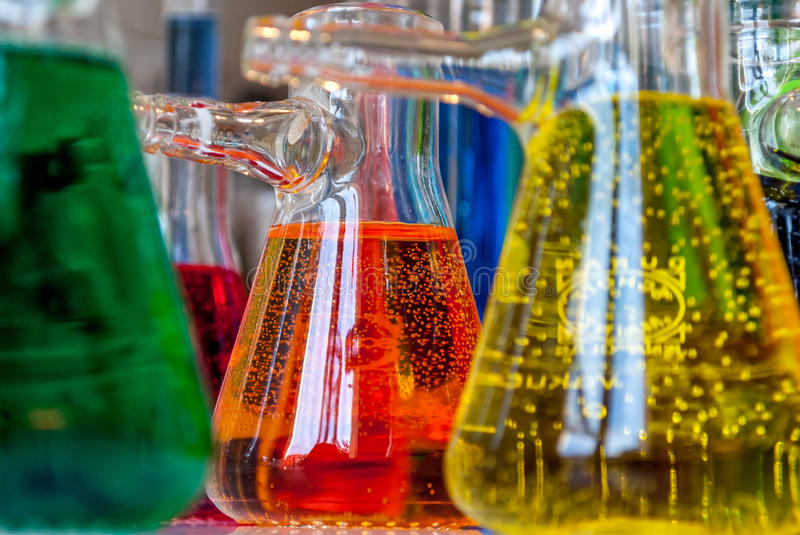 Chemistry bubbles. Colored solutions with bubbles in glassware are meaningful for science, chemistry and environment or chemical industry royalty free stock photography