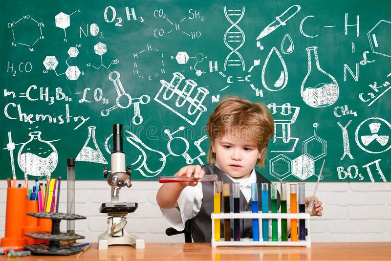 A chemistry demonstration. School concept. Experiment. Back to school. Biology experiments with microscope. Blackboard royalty free stock photos