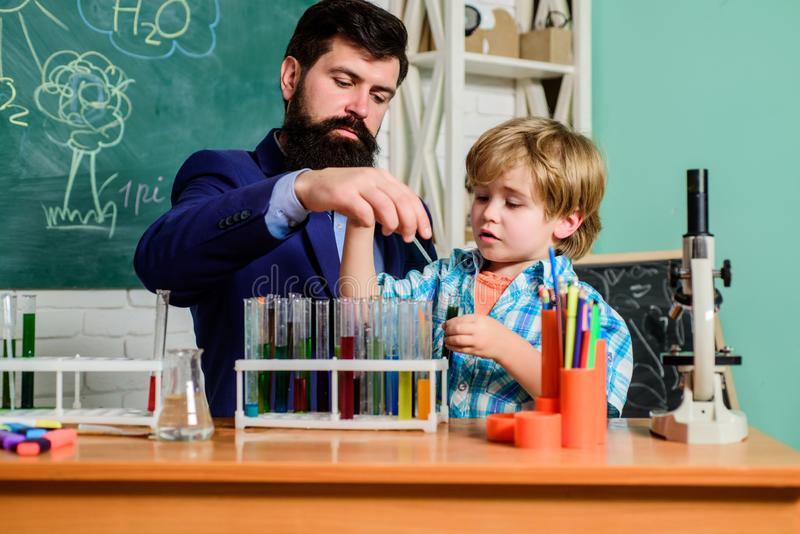 Chemistry experiment. School clubs interactive education. Teacher and pupils test tubes in classroom. After school clubs. Are great way to develop kids in royalty free stock photography