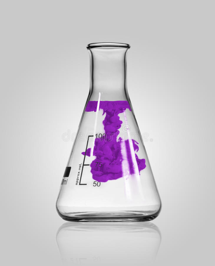 Chemistry glass with colored substance stock photos