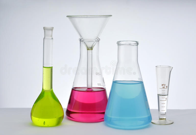 Chemistry glassware. Colorful chemistry glassware with white background stock images