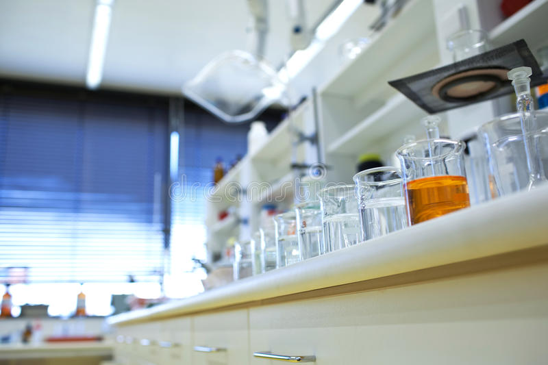 Chemistry lab. (shallow DOF; focus on the beakers in the foreground