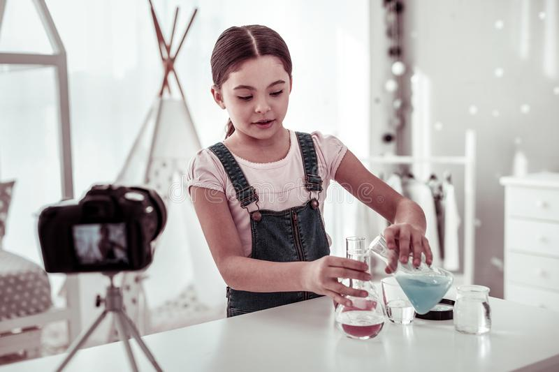 Smart serious girl doing a chemical test royalty free stock photos