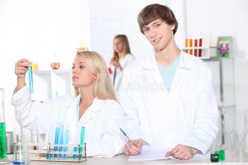 Chemistry students royalty free stock photos