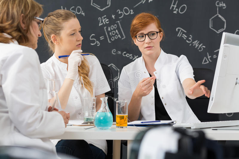 Chemistry students and their teacher royalty free stock photography