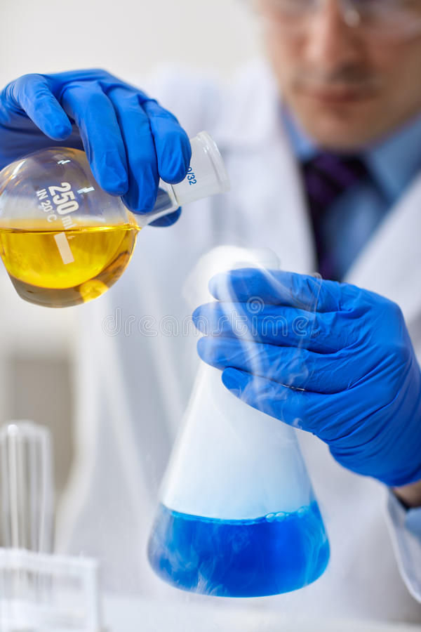 Chemistry test at science lab royalty free stock images