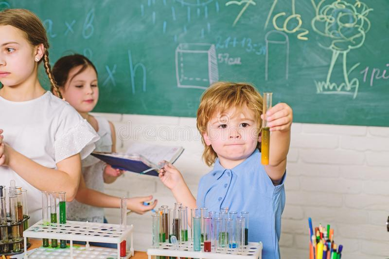 Chemistry themed club. School club education. Teacher and pupils test tubes in classroom. Kids can grow in area of club royalty free stock image