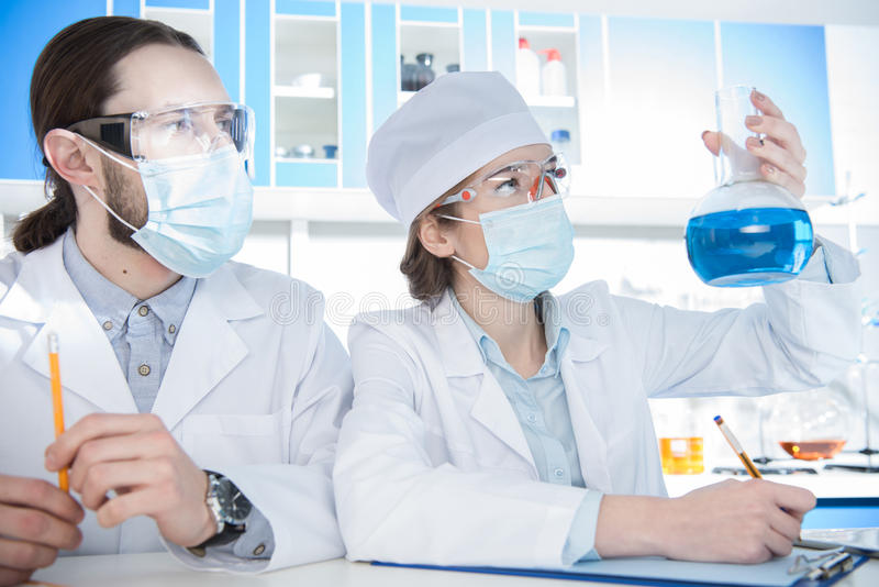 Chemists making experiment royalty free stock image