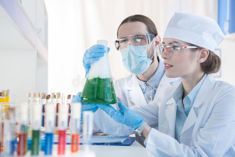 Chemists making experiment royalty free stock photography