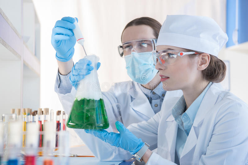 Chemists making experiment royalty free stock images