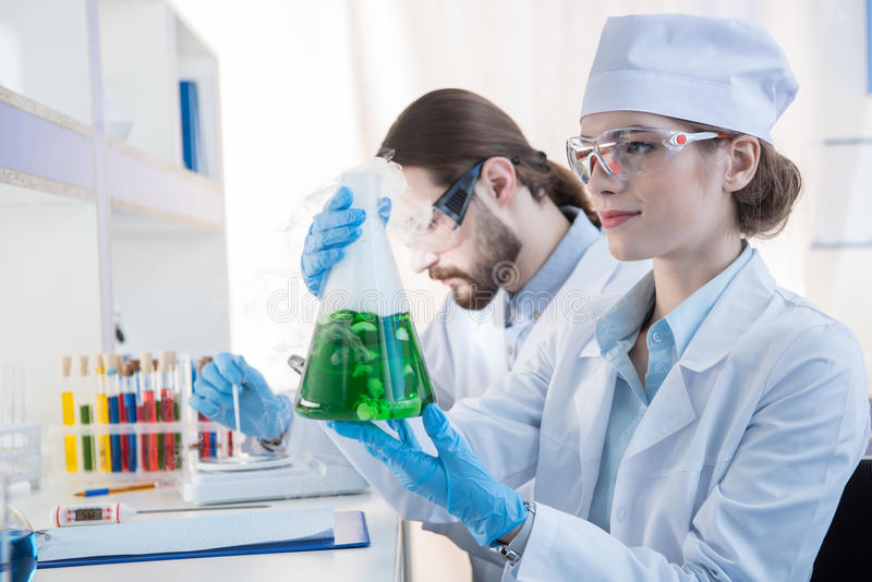 Chemists making experiment stock photo