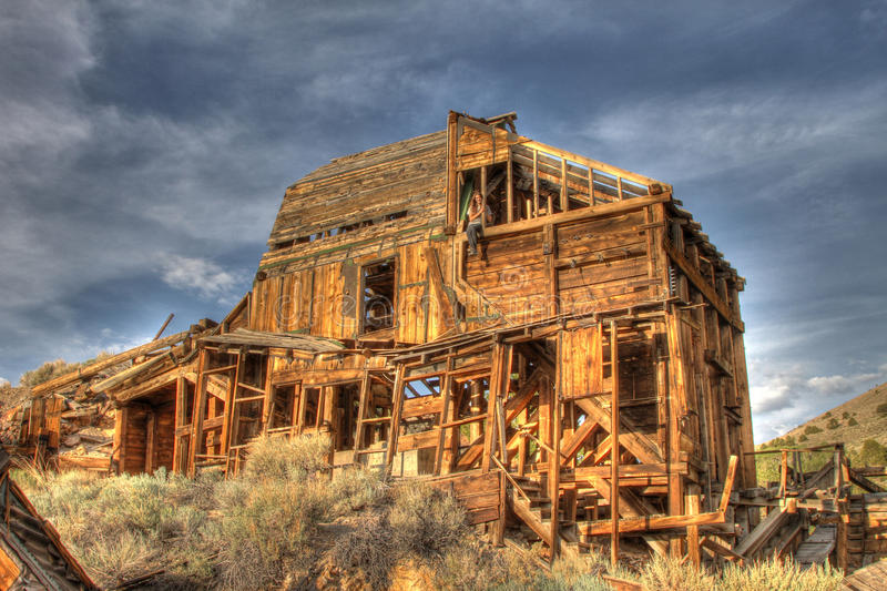 Chemung Mine with girl sitting on upper floor.. royalty free stock image