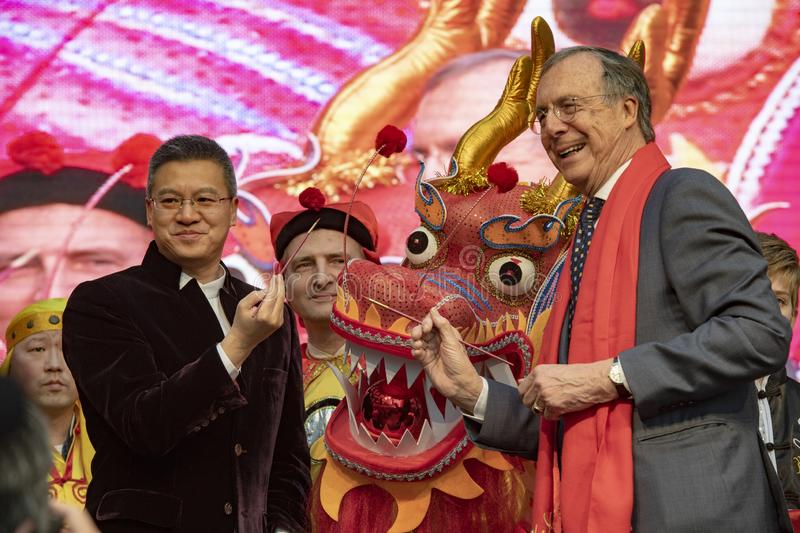 Chen Ribiao and Laurens Jan Brinkhorst celebrating CNY 2019. Mr. Chen Ribiao, Minister Counselor of Chinese Embassy left Mr. Laurens Jan Brinkhorst, former royalty free stock photography