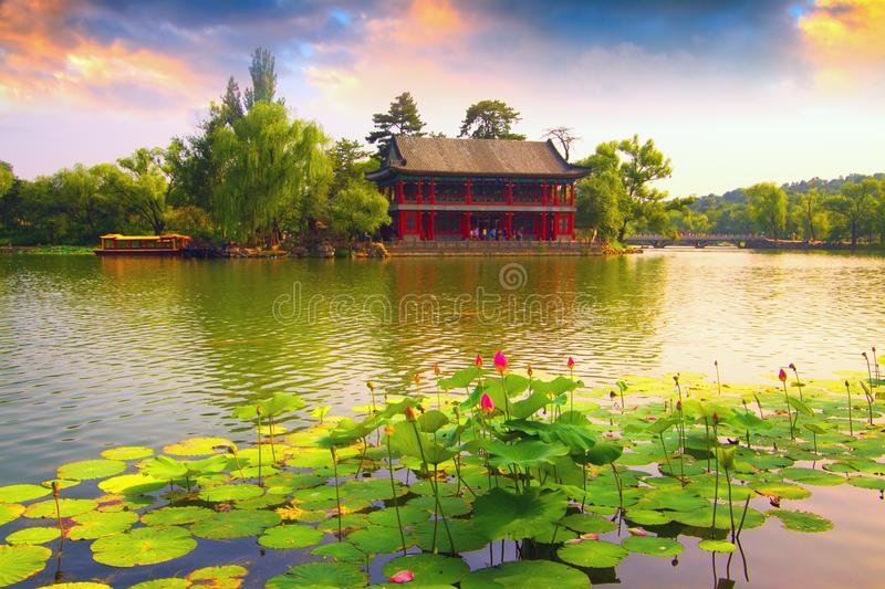 Chengde Imperial Summer Resort, Heibei, China. Panorama landscape of Imperial Summer Resort, landmark of Chengde city. Lotus flowers in front, traditional royalty free stock image