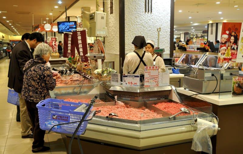 Chengdu, China: Abnehmer am chinesischen Supermarkt stockfotos