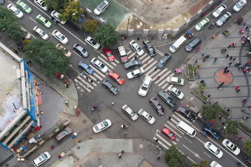 Heavy traffic in a small streets crossroads vertical view. Chengdu, China - March 17, 2017 : Heavy traffic in a small streets crossroads vertical view royalty free stock image