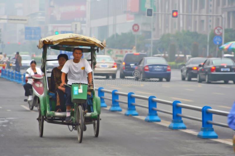 chengdu porcelanowa pedicab droga zdjęcie royalty free