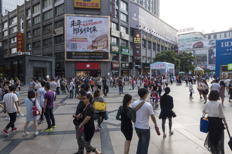 Chengdu shopping street. Shoppers and visitors crowd at a shopping street ,chunxi street,chinese famous business walking street in chengdu royalty free stock photography